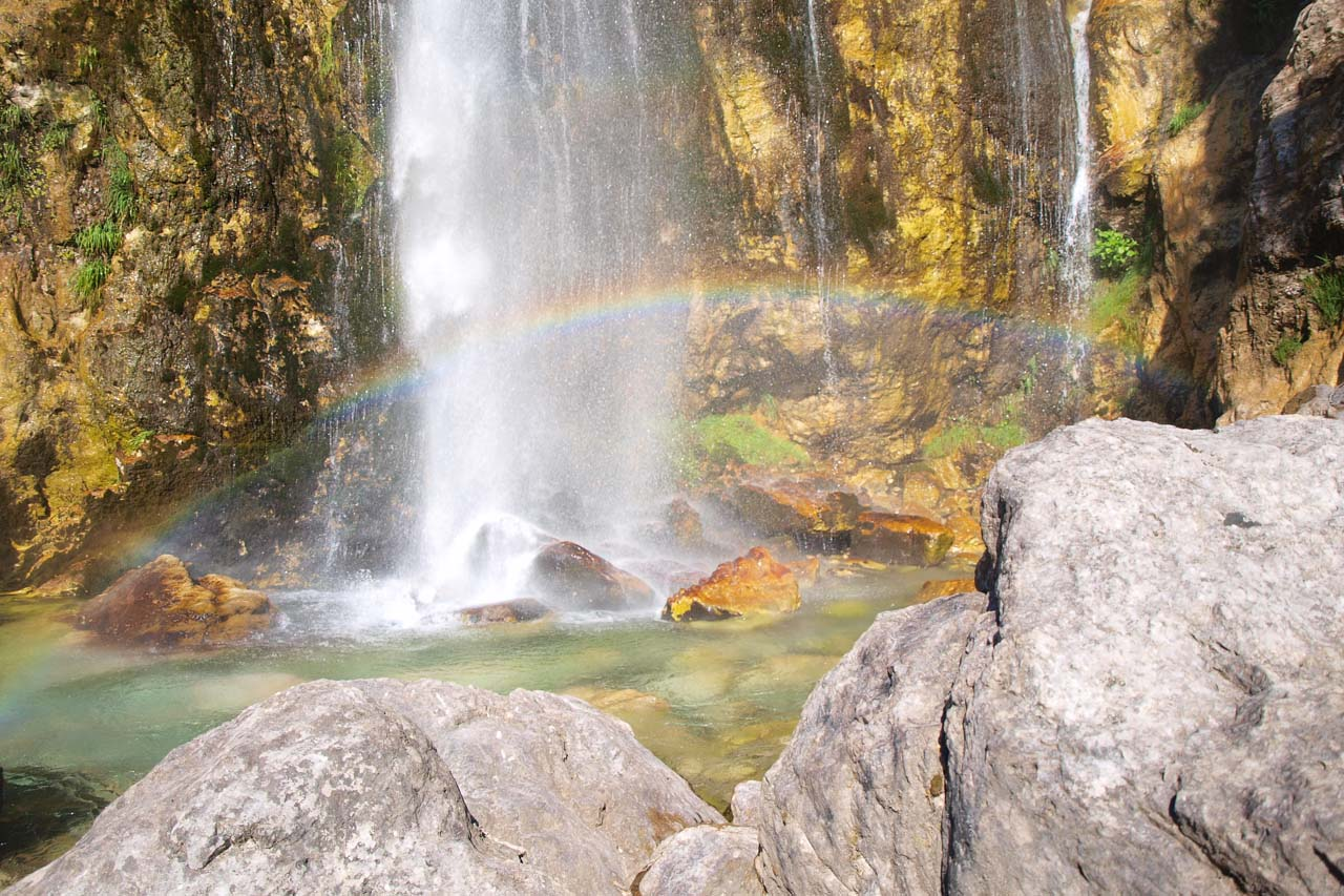 Often the sun creates a rainbow at the base of the waterfall