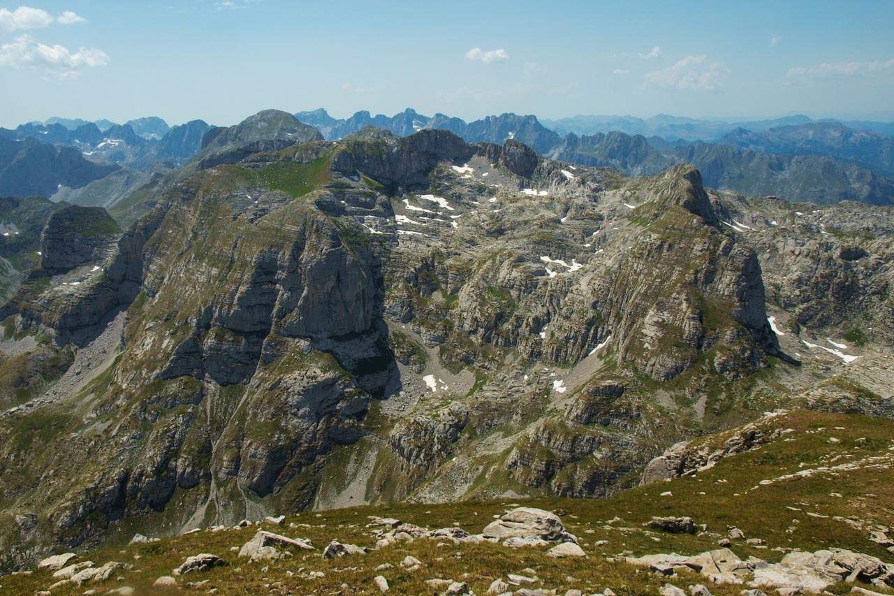 Bjelic Massif with Maja e Rosit (2524m) barely visible behind, further in the back the Karanfil Chain