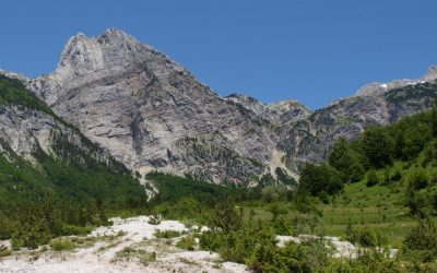 Down in the valley, looking back to where we came from: Peja Pass is the lowest pointin the range, while the left of the photo is dominated by Arapi's big wall