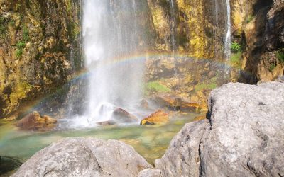 Often the sun creates a rainbow at the base of the Grunas waterfall