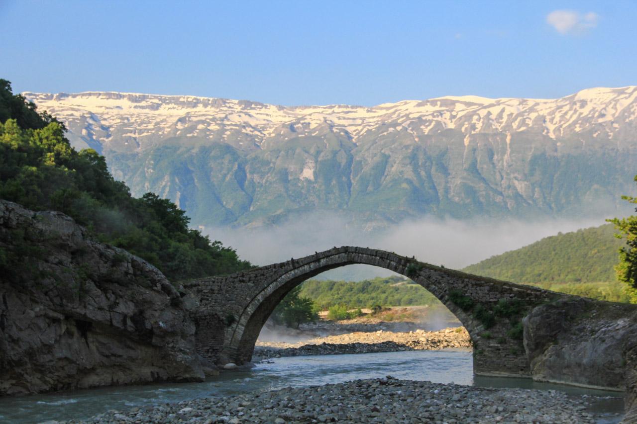 Ottoman bridge at Benje hot springs, Nemercka range in the background