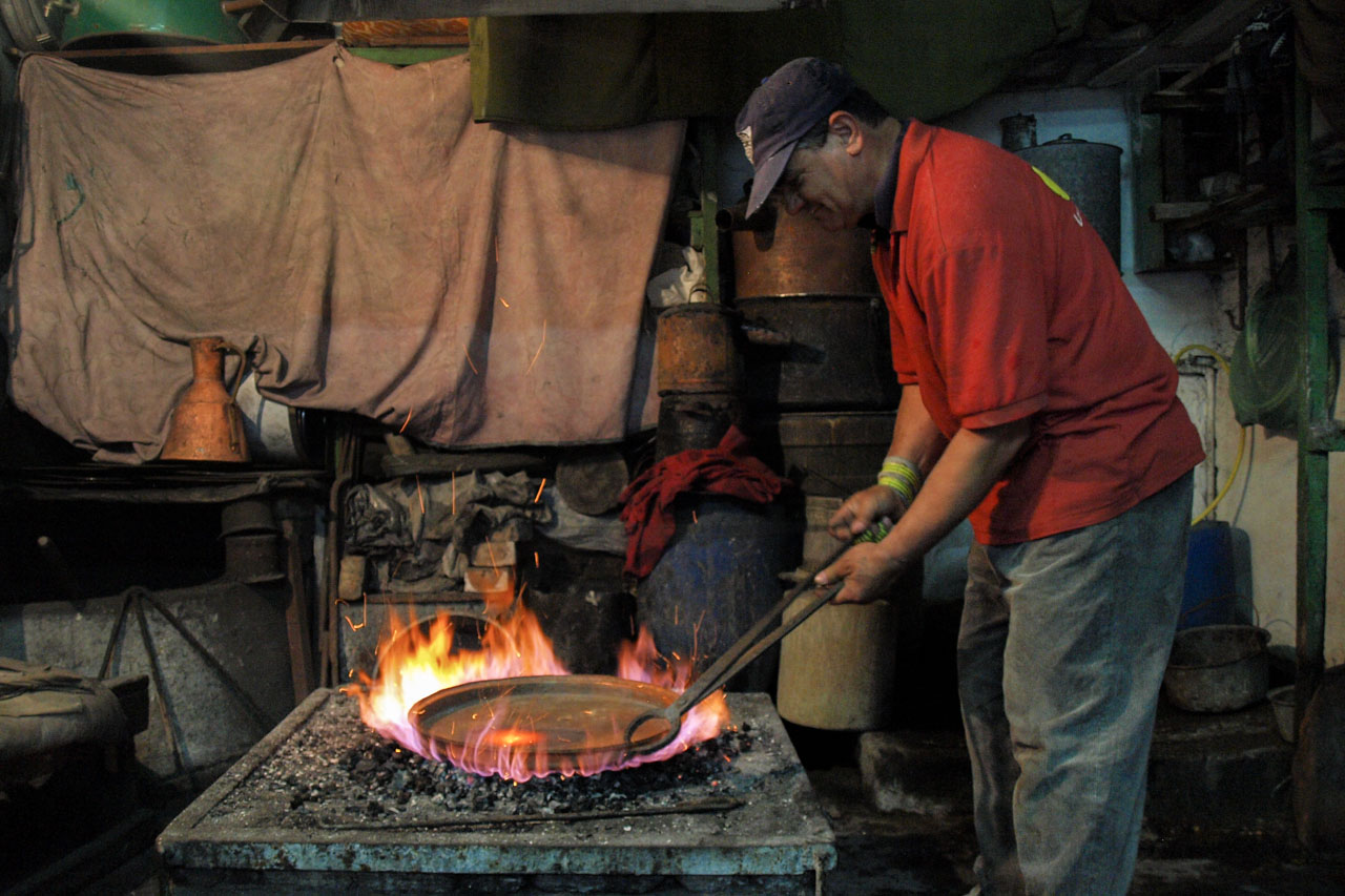 Traditional copper smith at work