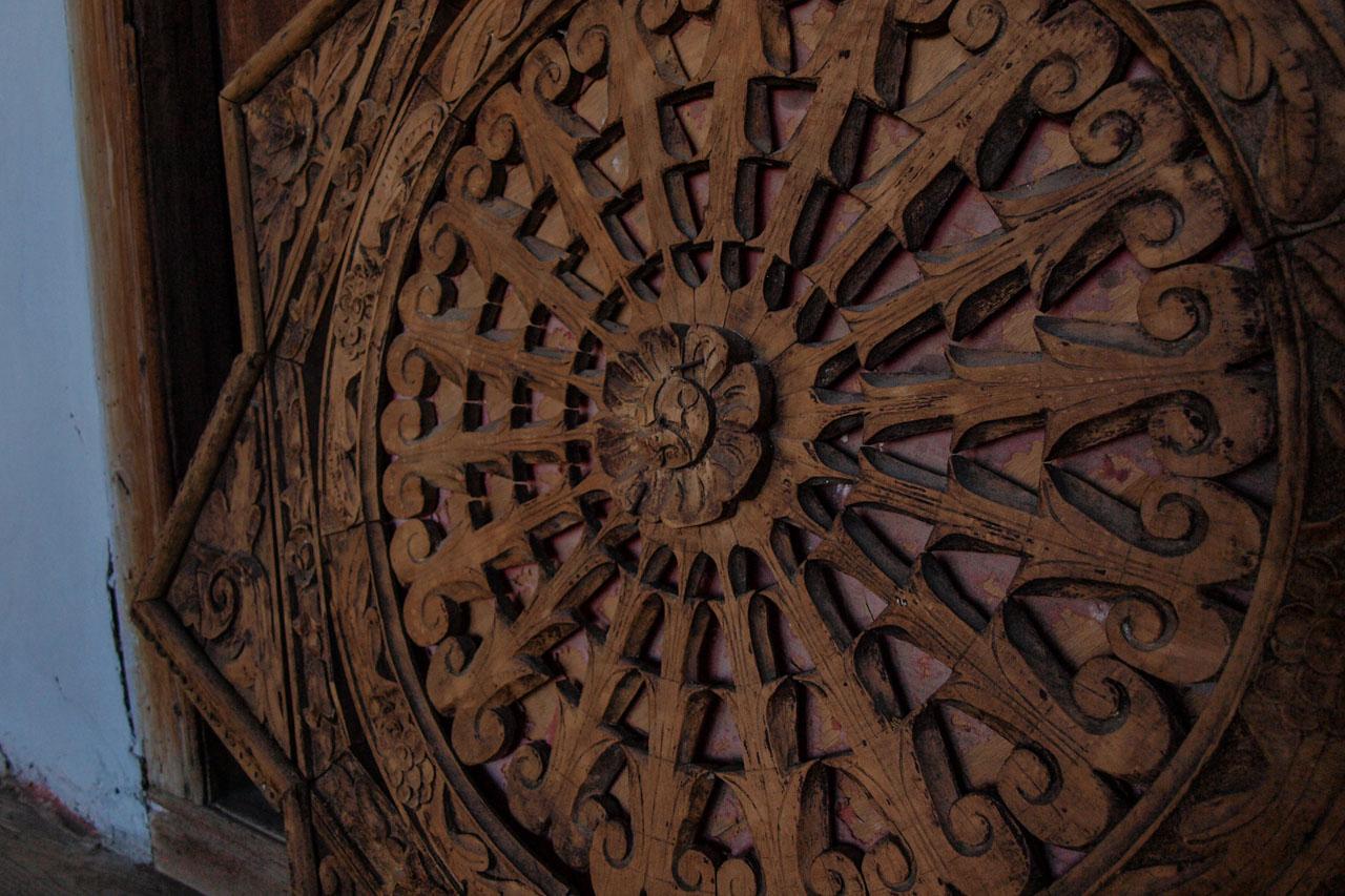 Elaboate wood carvings decorate the ceilings